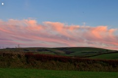 Dramatic clouds lit by the setting sun over Exmoor near Challacombe