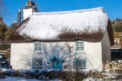 Thatched cottage in Georgeham with snow