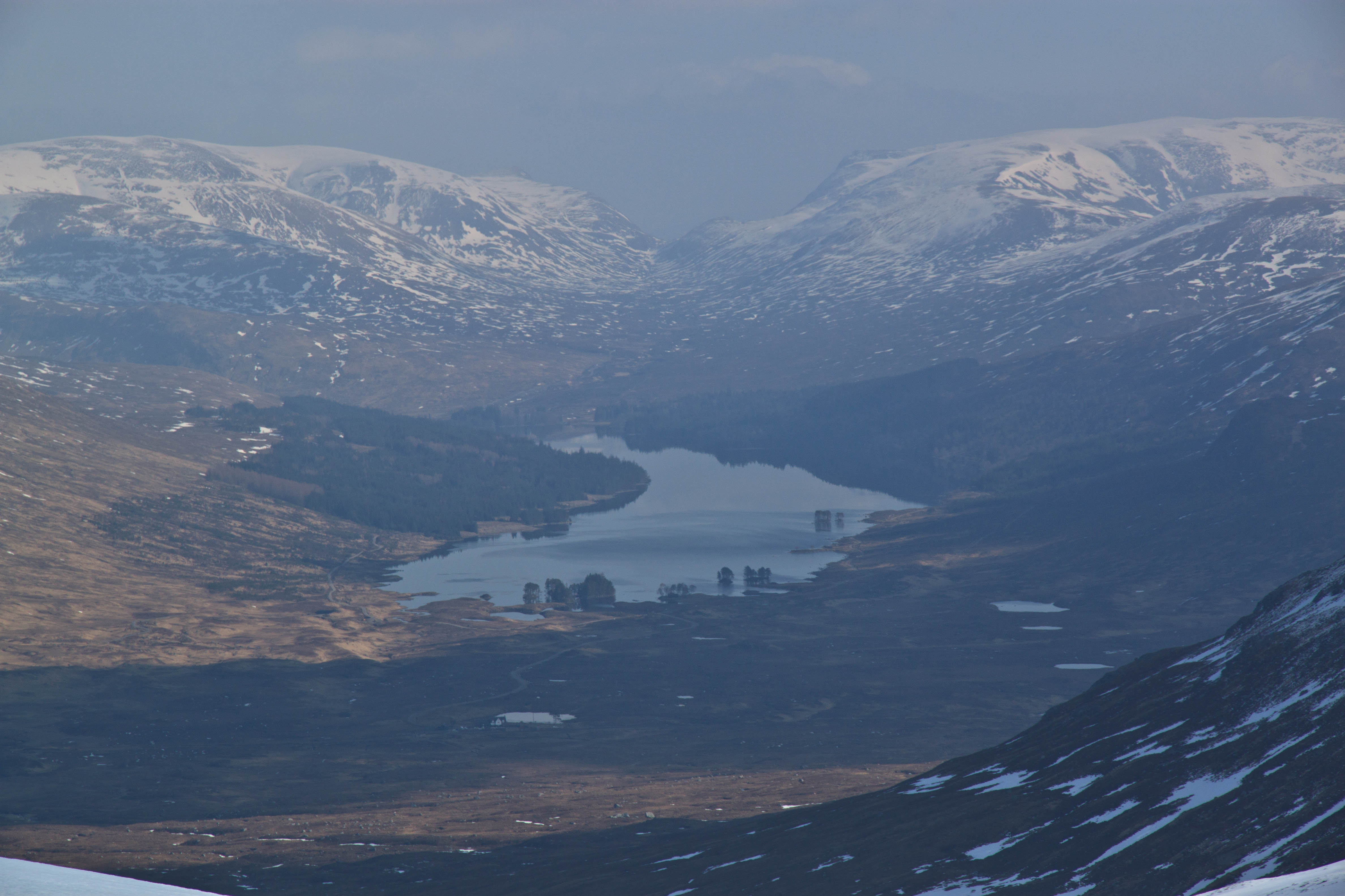 View north east from summit of Leum Uilleim towards Loch Ossian. Beinn na Lap on the left and Sgor Gaibhre on the right. Corrour station just visible centre bottom. March 2015.