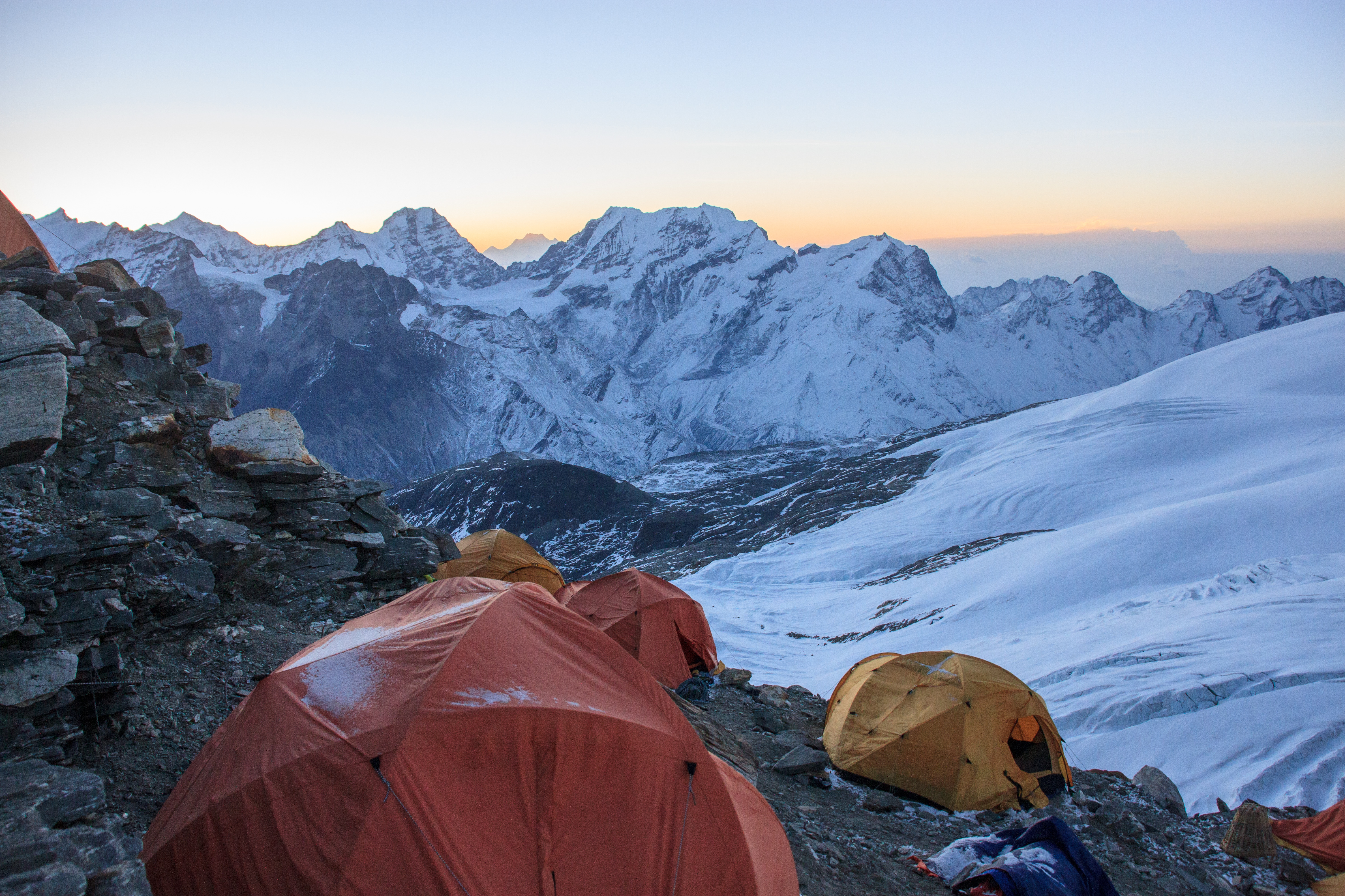Peeking out of the tent at High Camp at sunrise