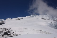 View from Base Camp towards the summit. High Camp is just beyond the rocky outcrop centre picture.