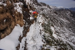 One of our porters on the narrow and icy path to the Zatrwa La.