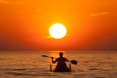 Fisherman in Kayak off Putsborough Beach.