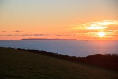 Lundy Island in the setting sun seen from Saunton Down