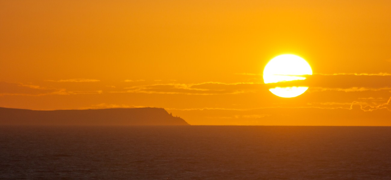 9479_Sunset-over-Lundy-Island-from-Baggy-Point_cropped-1
