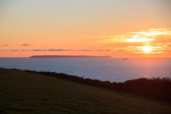 Lundy Island in the setting sun seen from Saunton Down