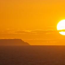 Sunset behind Lundy Island from Baggy Point in April