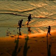 Children at play on Putsborough Beach in June