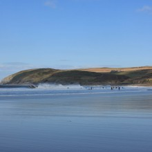 Croyde Bay with Baggy Point beyond on an epic surfing day
