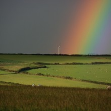 Rainbow lights up the Mullacot wind turbine in August