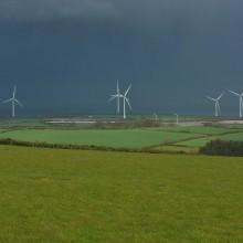 Fullabrook wind farm against dark April clouds