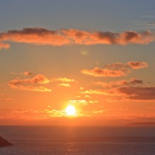 Sunset over Baggy Point and Lundy Island. March 2013