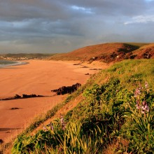 Cover Photo: Putsborough Beach bathed in evening light in April