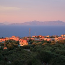 Sunset over Capo d'orlando. Aeolian Islands beyond.