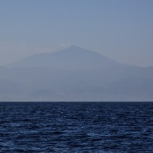 Mt Etna from boat to Lipari. Steam faintly visible rising from the summit.